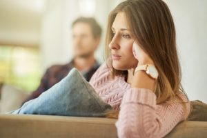 a woman contemplates if she should get a divorce